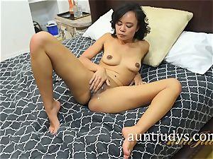 Annie Cruz fingers and spanks her Mature slit