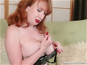 chesty crimson finger romps cunt in garter nylons and pumps