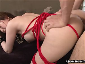 spurting chinese is trussed up and used in a threesome