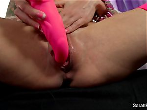 Sarah Jessie drills herself with a pink toy