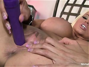 super-steamy platinum-blonde Nikita plays with a purple fucktoy